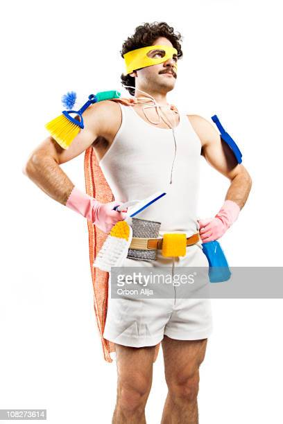 man wearing superhero mask and cleaning supplies with cape - janitor stock photos and pictures
