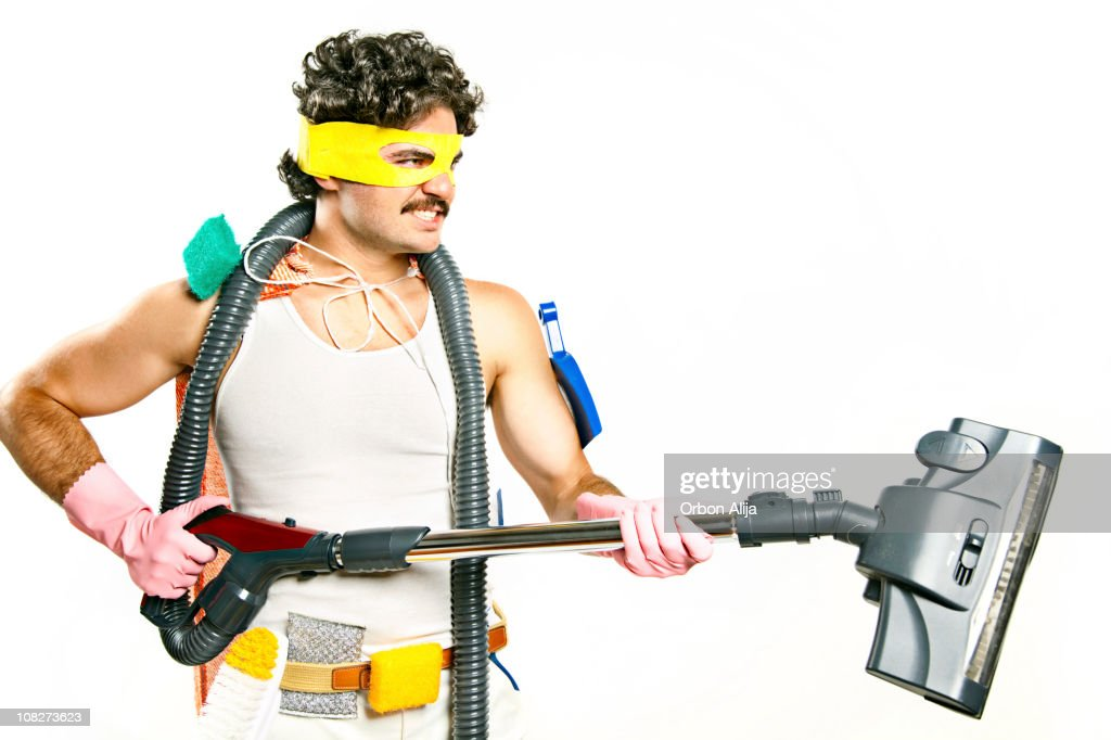 Man Wearing Superhero Mask Holding Vacuum and Cleaning Supplies : Stock Photo