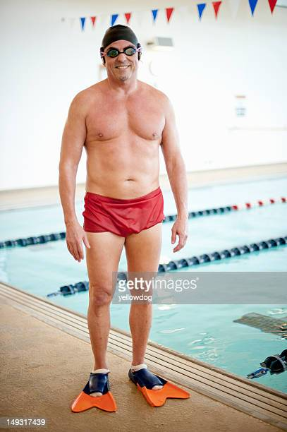 man wearing swim gear at pool - zwembroek stockfoto's en -beelden