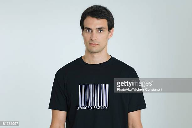 Man wearing tee-shirt with bar code, portrait