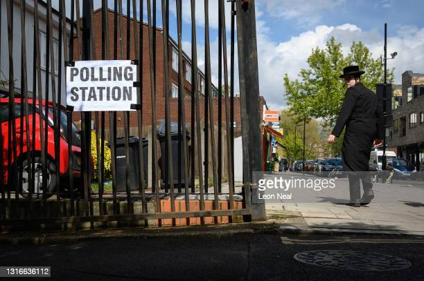 Man wearing the clothes of the Orthodox Jewish faith walks past a polling station on May 06, 2021 in London, United Kingdom. Local elections are...