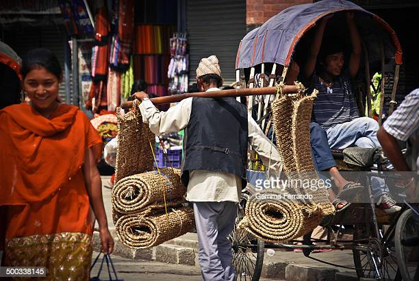 CONTENT] Man wearing the traditional hat and feeding pigeons in a busy commercial street in the heart of Kathmandú the capital and largest urban...