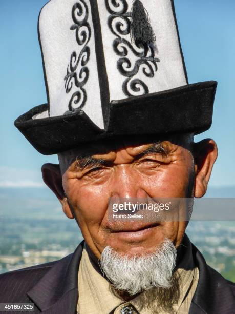 Man wearing the traditional national hat of Kyrgyzstan, the Kalpak. I made this portrait on the sacred mountain of the city of Osh, the Suleiman-Too...