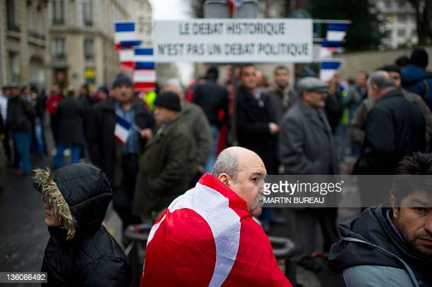 A man wearing the Turkish flag takes part in a rally next to the French National Assembly on December 22 2011 in Paris as the French parliament is...
