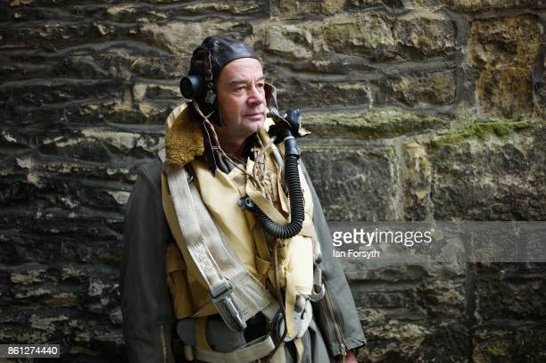 A man wearing the uniform of an airman poses for a picture during the North Yorkshire Moors Railway 1940's Wartime Weekend event on October 14 2017...