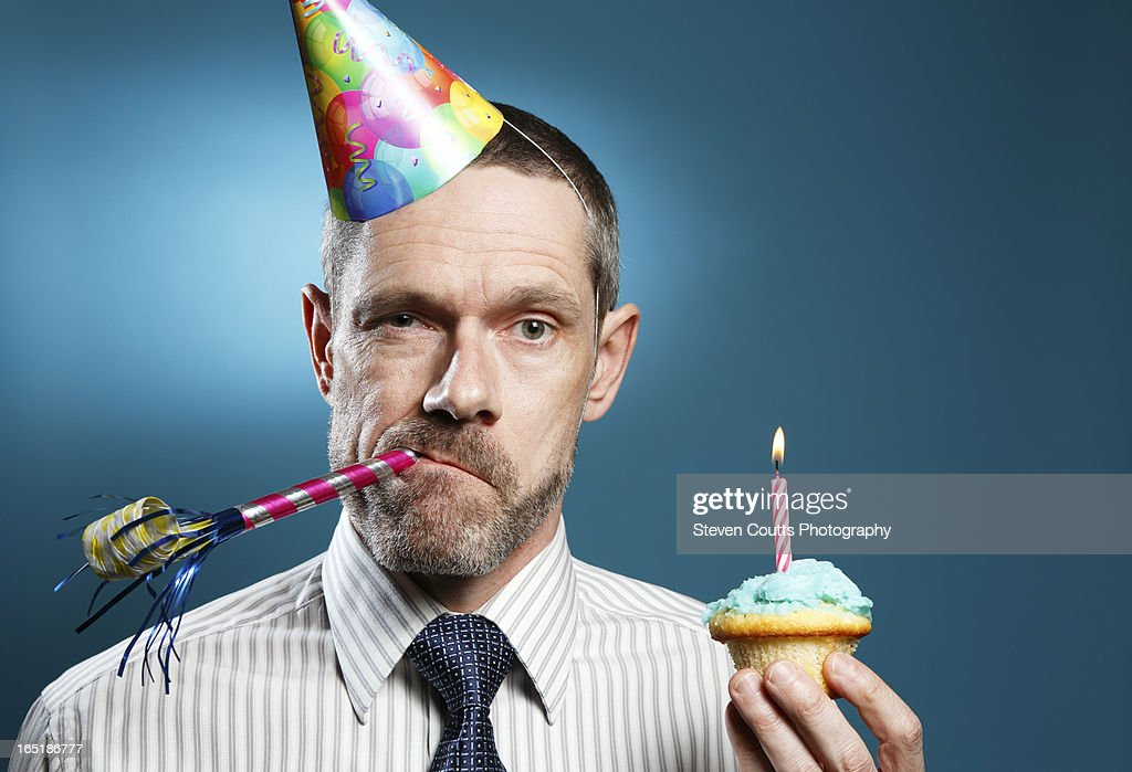 Man Wearing Tie With Party Hat Horn Blower And Cup : Stock Photo