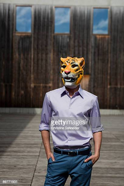 man wearing tiger mask outdoor