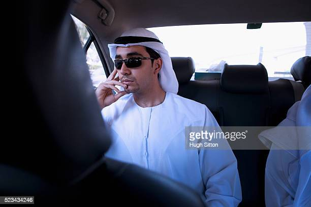 man wearing traditional clothing in car - hugh sitton stock pictures, royalty-free photos & images