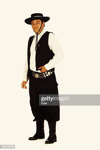man wearing traditional clothing - argentina traditional clothing stock photos and pictures