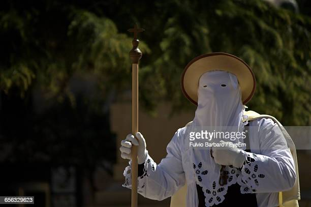 man wearing traditional clothing walking on street during easter - happy easter in italian stock pictures, royalty-free photos & images