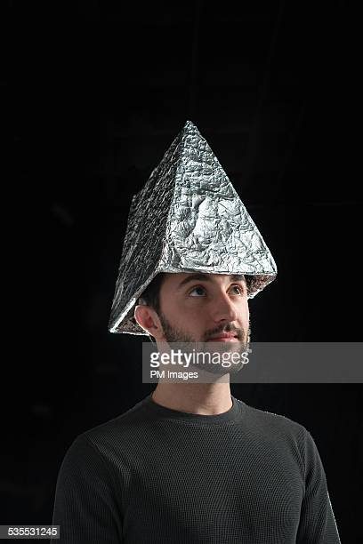 Man wearing triangle foil hat