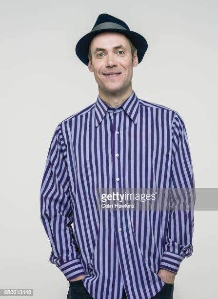 man wearing trilby hat - purple shirt stock photos and pictures