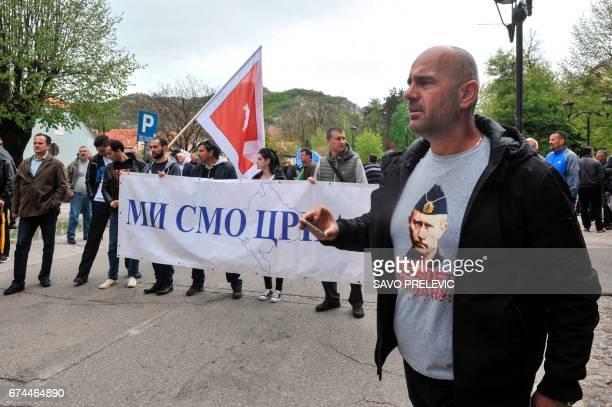 A man wearing tshirt with an image of Russian President Vladimir Putin participates in a protest against the Montenegro's accession to NATO in...
