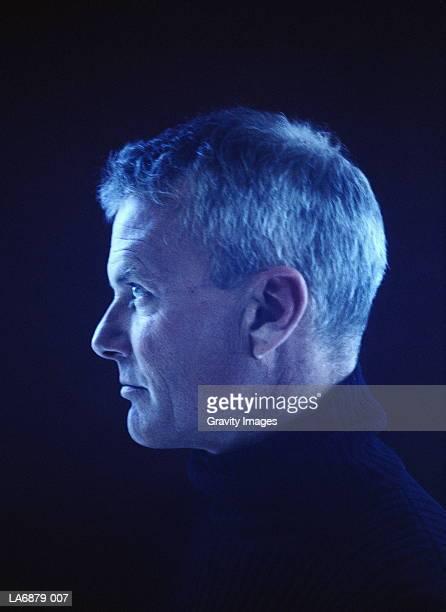 Man wearing turtleneck jumper, profile, close-up
