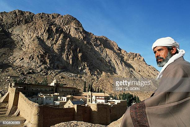 A man wearing typical clothes in front of St Catherine's Monastery Sinai Egypt