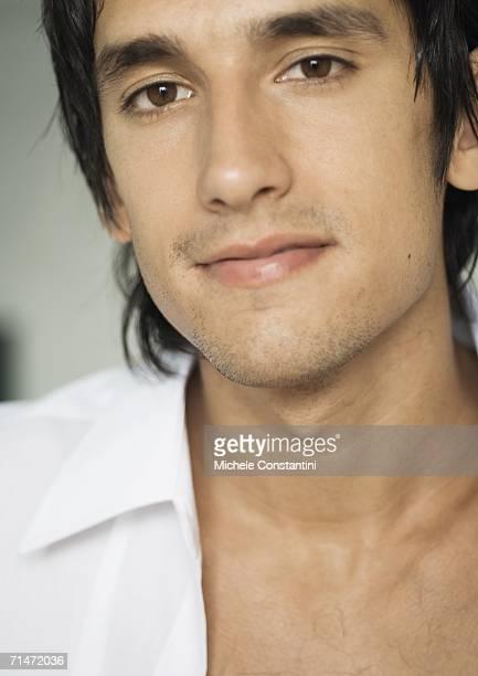 man wearing unbuttoned dress shirt, close-up - オープンネック ストックフォトと画像