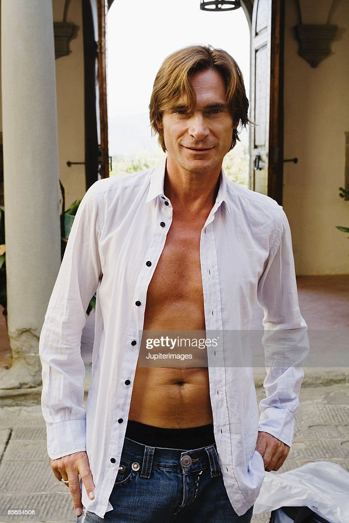 man wearing unbuttoned shirt stock photo getty images