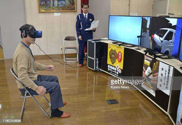 A man wearing virtual reality goggles in Sapporo northern Japan watches a video on Nov 13 featuring ways to prevent traffic accidents involving...