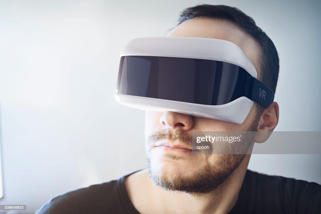 Man wearing virtual reality headset : Stock Photo