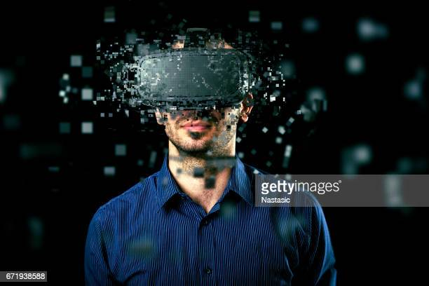 man wearing virtual reality headset - virtual reality simulator stock photos and pictures