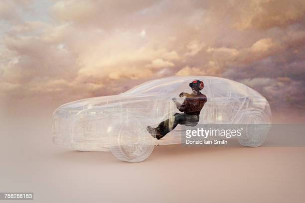 man wearing virtual reality helmet driving car - automotive stockfoto's en -beelden