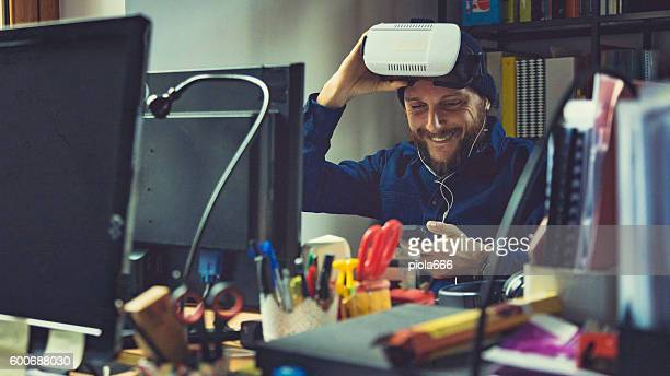man wearing virtual reality vr headset at office - stereoscopic images stock photos and pictures