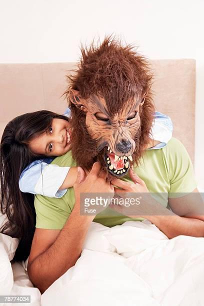 man wearing werewolf mask to bed - lobisomem imagens e fotografias de stock