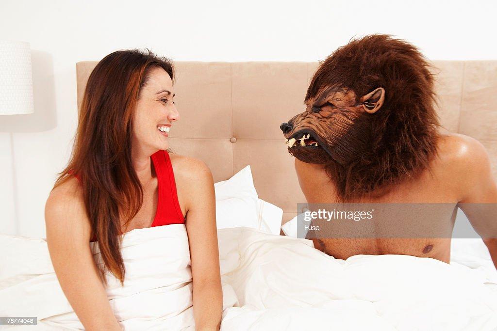 Man Wearing Werewolf Mask to Bed : Foto de stock