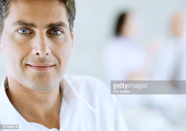 man wearing white shirt with open collar, portrait - out of frame stock pictures, royalty-free photos & images