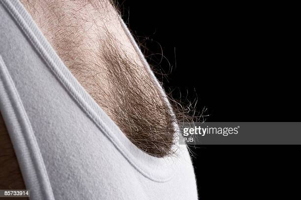 man wearing white vest, close-up - hairy chest stock photos and pictures