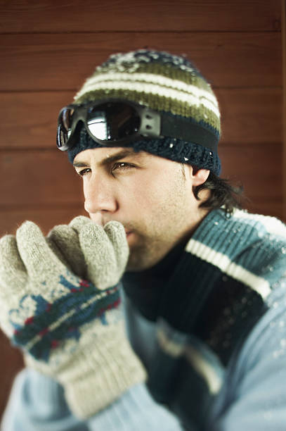 Man wearing winter hat and gloves