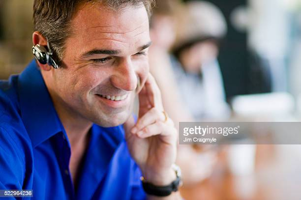 man wearing wireless headset - jim craigmyle stock pictures, royalty-free photos & images