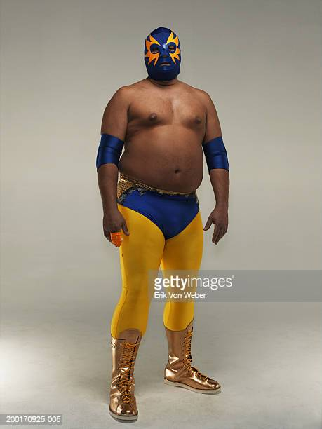 Man wearing wrestler costume and mask