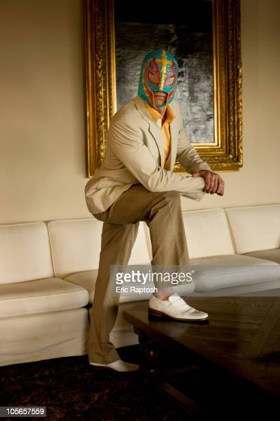 Man wearing wrestling mask in living room