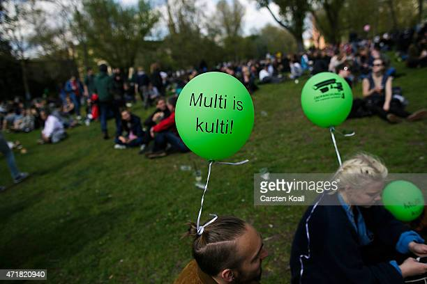 A man wears a ballon with the slogan 'Multi is kulti' during the annual MyFest in Kreuzberg district on May 1 2015 in Berlin Germany May Day or...
