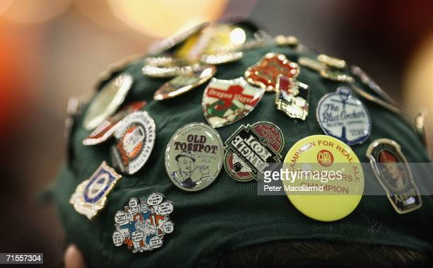 Man wears a baseball cap covered in badges at the Great British Beer Festival on August 1, 2006 in London. The Great British Beer Festival runs from...