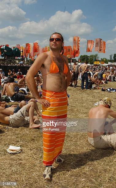 A man wears a bikini and sarong at the 2003 Glastonbury Festival at Pilton in Shepton Mallett Glastonbury on June 22 2003 in England