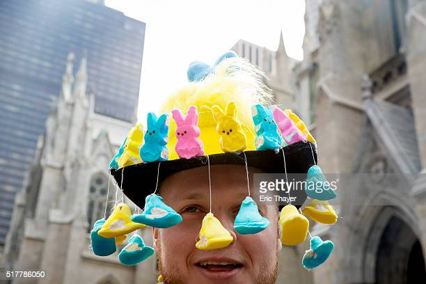 A man wears a bonnet during the Easter Parade and Bonnet Festival along 5th Avenue March 27 2016 in New York City The parade is a New York tradition...