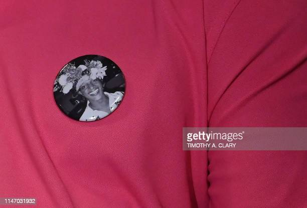 A man wears a button with a picture of transgender activist Marsha P Johnson during an event at the The Lesbian Gay Bisexual Transgender Community...