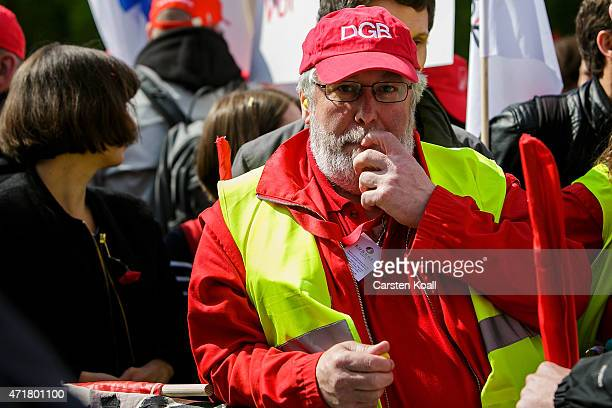 A man wears a cap with the the sign of the DGB on a rally of the German Confederation of Trade Unions on May 1 2015 in Berlin Germany May Day or...