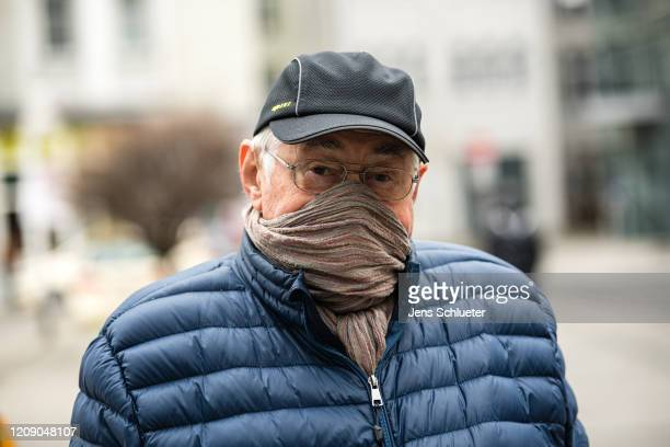 A man wears a cloth as a protective face mask on April 3 2020 in Jena Germany A threepart city ordinance is going into effect requiring people to...