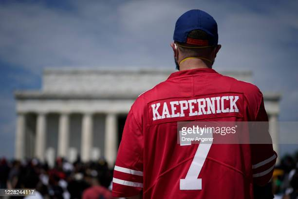 Man wears a Colin Kaepernick jersey during the March on Washington at the Lincoln Memorial August 28, 2020 in Washington, DC. Today marks the 57th...