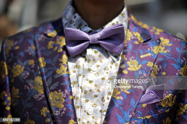 A man wears a colourful and flambouyant suit as he strolls along the Boulevard de la Croisette during the Cannes Film Festival on May 19 2017 in...