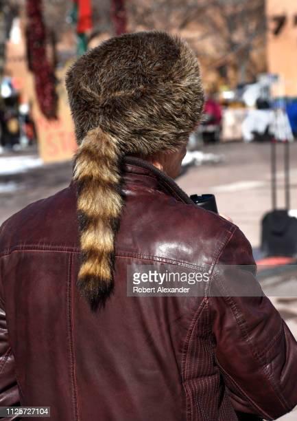 A man wears a coonskin cap in Santa Fe New Mexico
