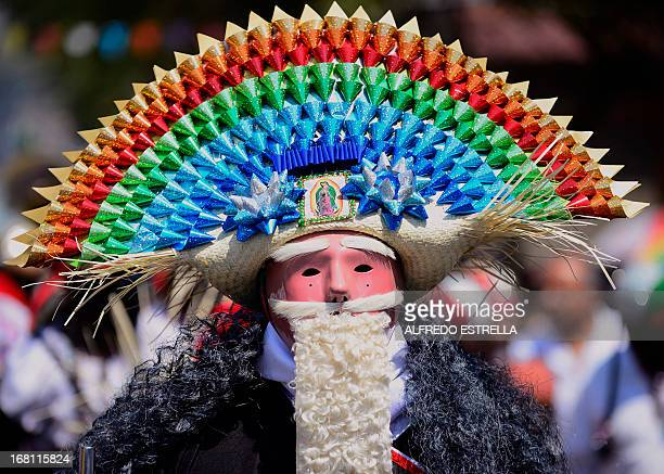 A man wears a costume along the streets of the Penon de los Banos neighborhood in Mexico City on May 5 commemorating the anniversary of Mexico's...