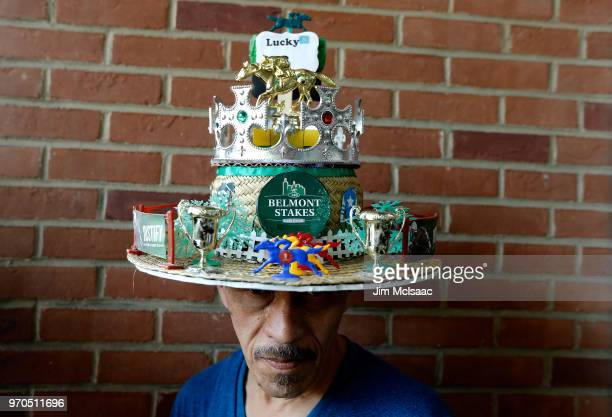 A man wears a decorative hat prior to the 150th running of the Belmont Stakes at Belmont Park on June 9 2018 in Elmont New York