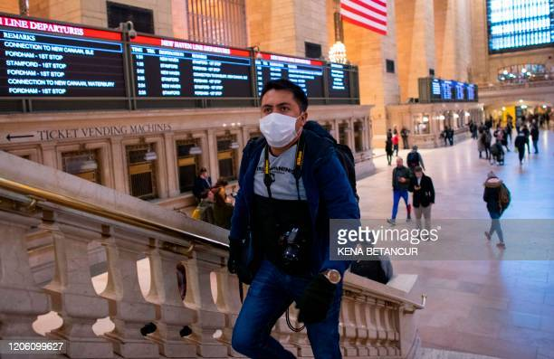 A man wears a face mask as he walks inside Grand Central Station on March 8 2020 in New York City The governor of New York on March 7 2020 announced...