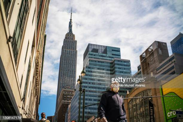 Man wears a face mask as the city streets are empty due to the coronavirus on March 24, 2020 in New York City. New York City has about a third of the...