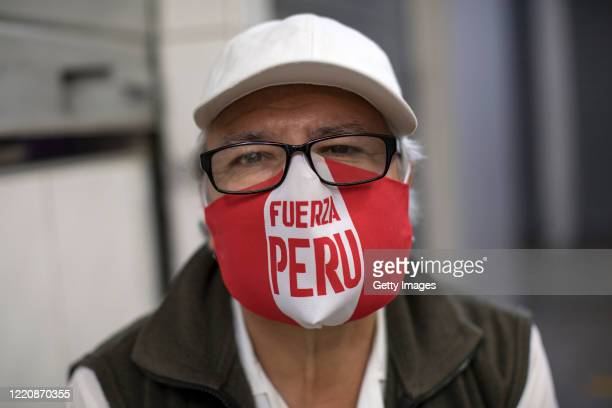 Man wears a face mask during coronavirus lockdown on April 24, 2020 in Lima, Peru. After 40 days of government-ordered lockdown and over 20,000...