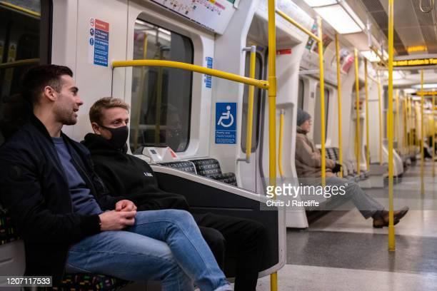 A man wears a face mask on the London Underground as the outbreak of coronavirus intensifies on March 14 2020 in London England Many Londoners and...